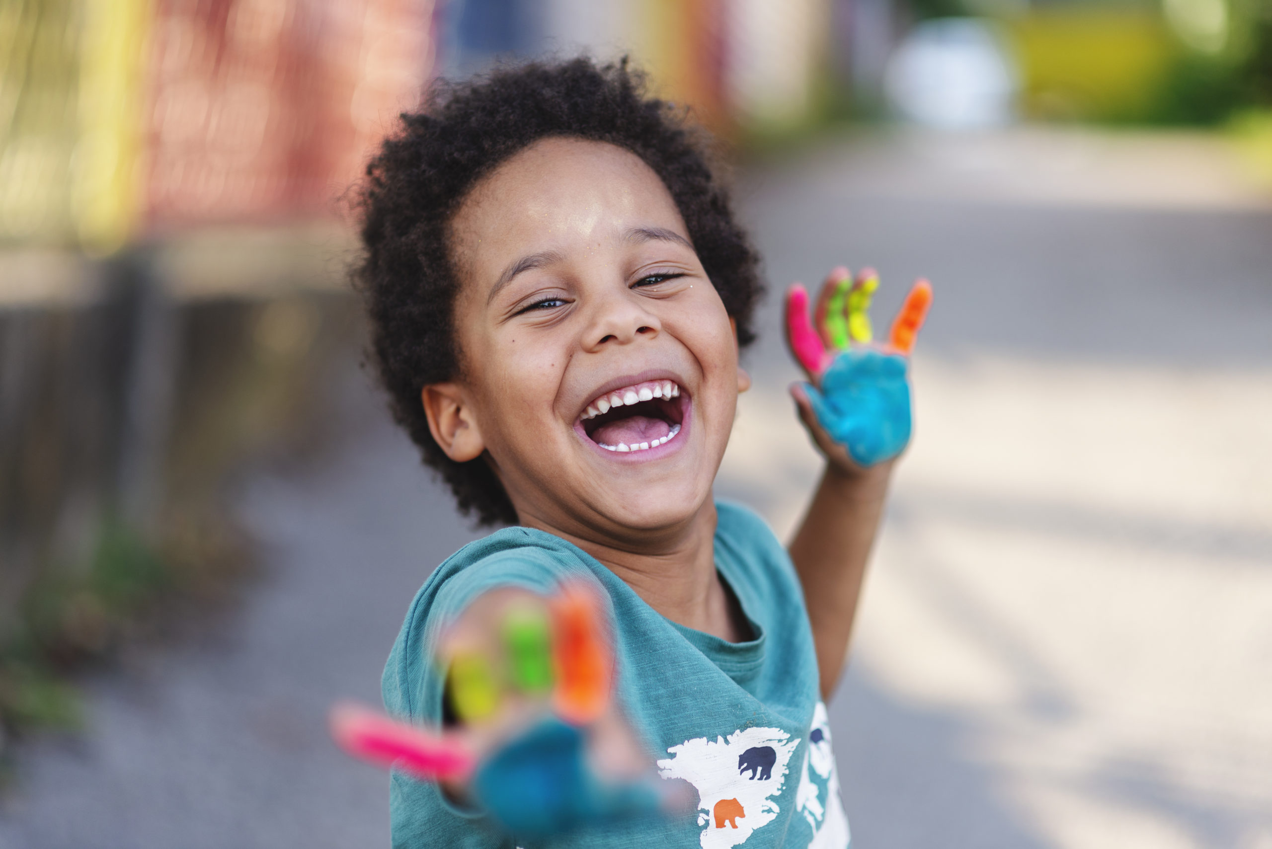 Best interests of the child concept. beautiful happy boy with painted hands not worried about the best interests of the child