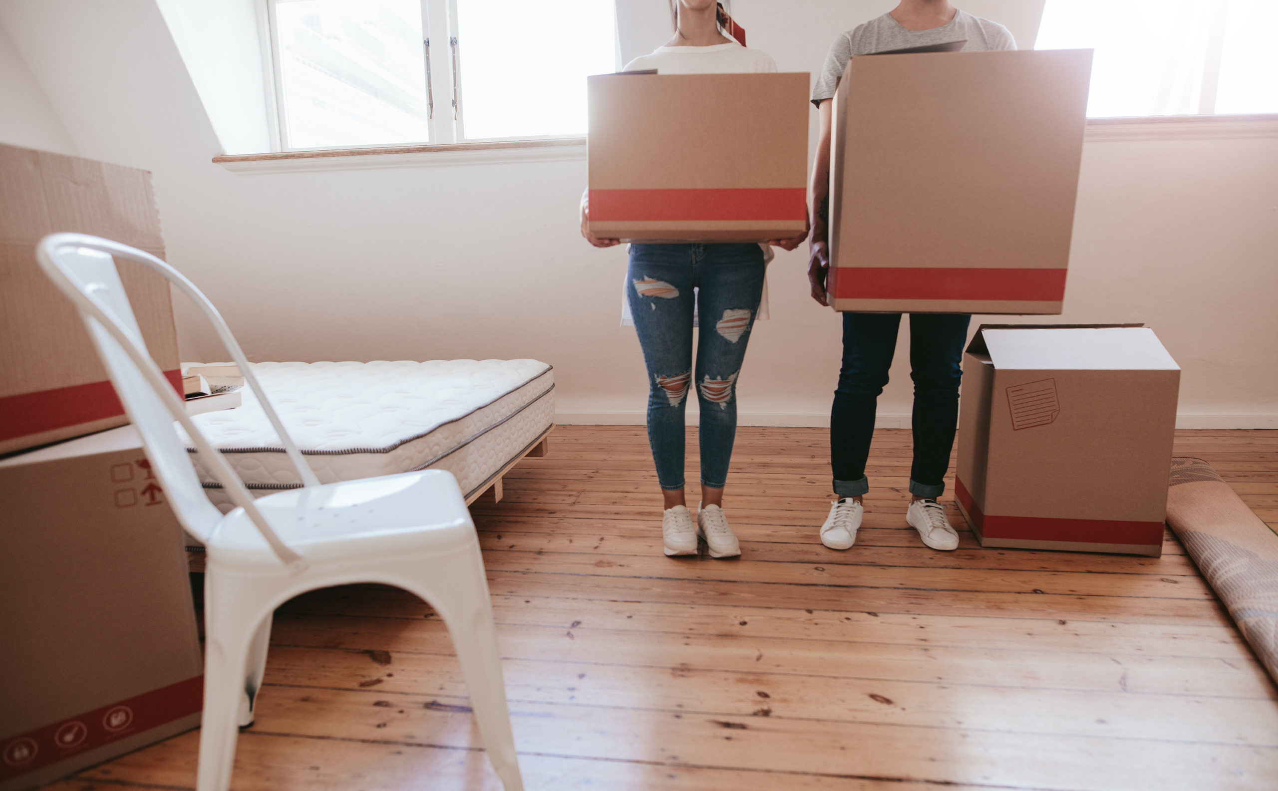 cohabitation spousal support concept. Couple with cardboard boxes moving to new house